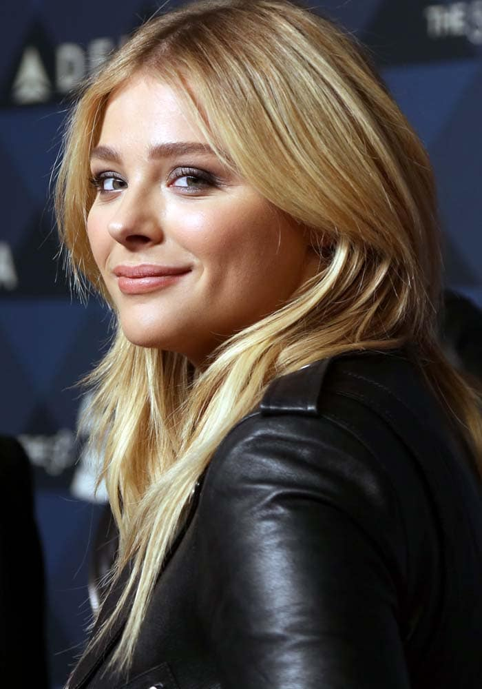 """Chloe Moretz keeps her makeup simple and wears her hair down at Delta Air's """"Sites & Sounds"""" Grammy Party"""