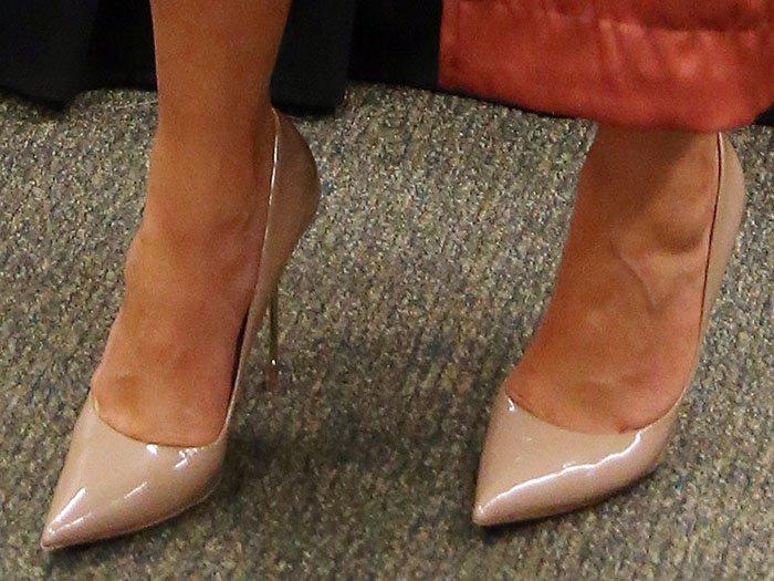 Chrissy Teigen's feet in nude leather Kurt Geiger pumps
