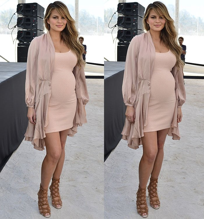 Chrissy-Teigen-cleavage-baby-bump-legs-fitted-dress