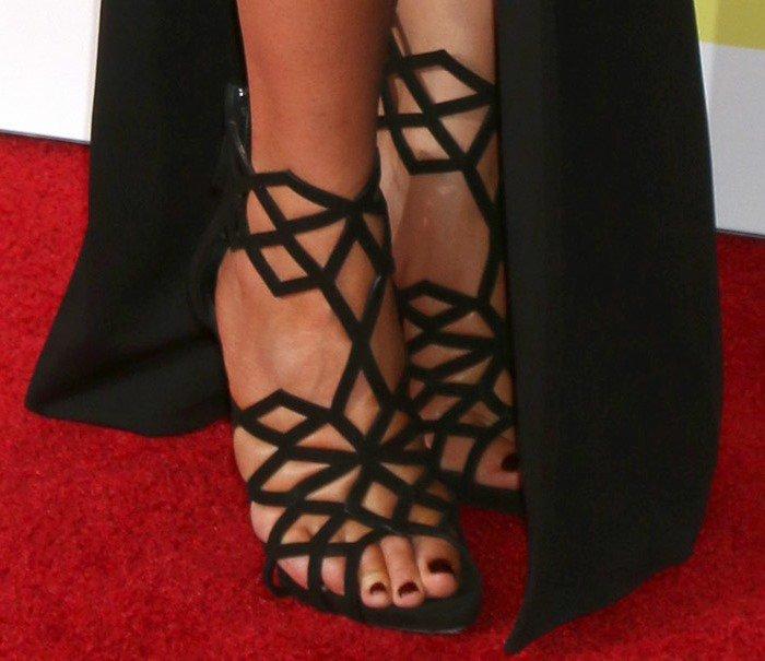 Chrissy Teigen's feet in caged Giuseppe Zanotti sandals