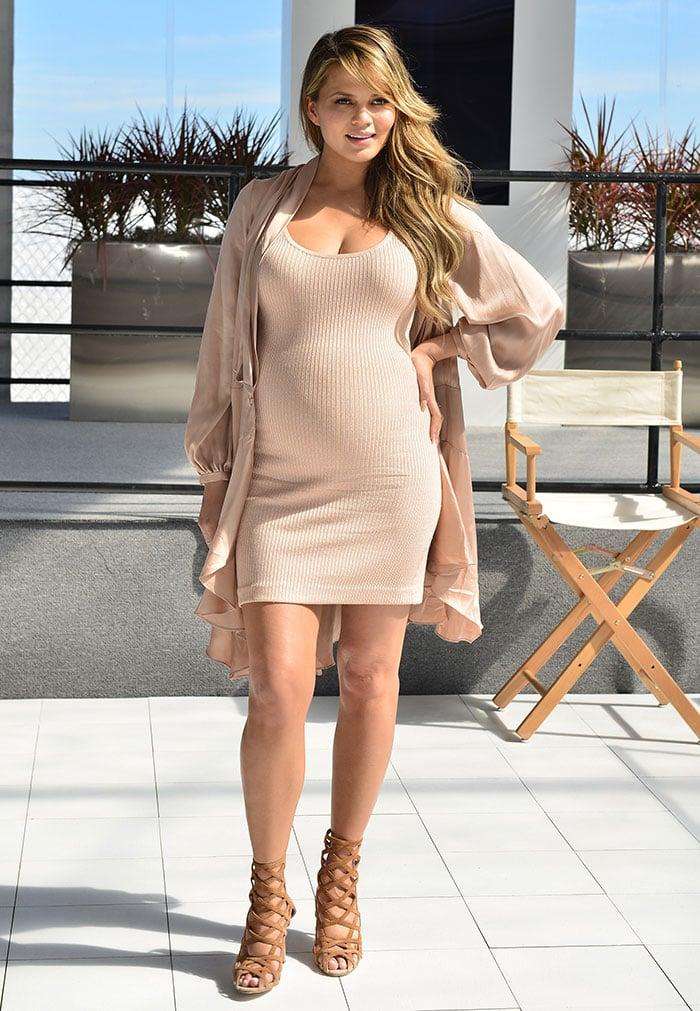 Chrissy-Teigen-tight-ribbed-pink-dress-silky-cardigan