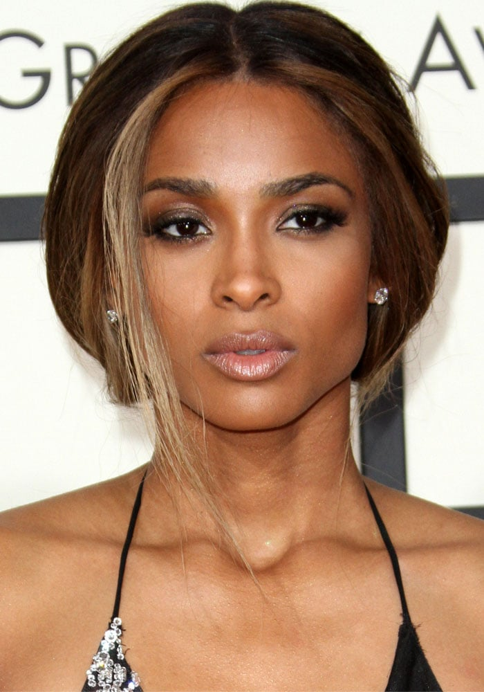 Ciara wears her hair down and back as she attends the 2016 Grammys