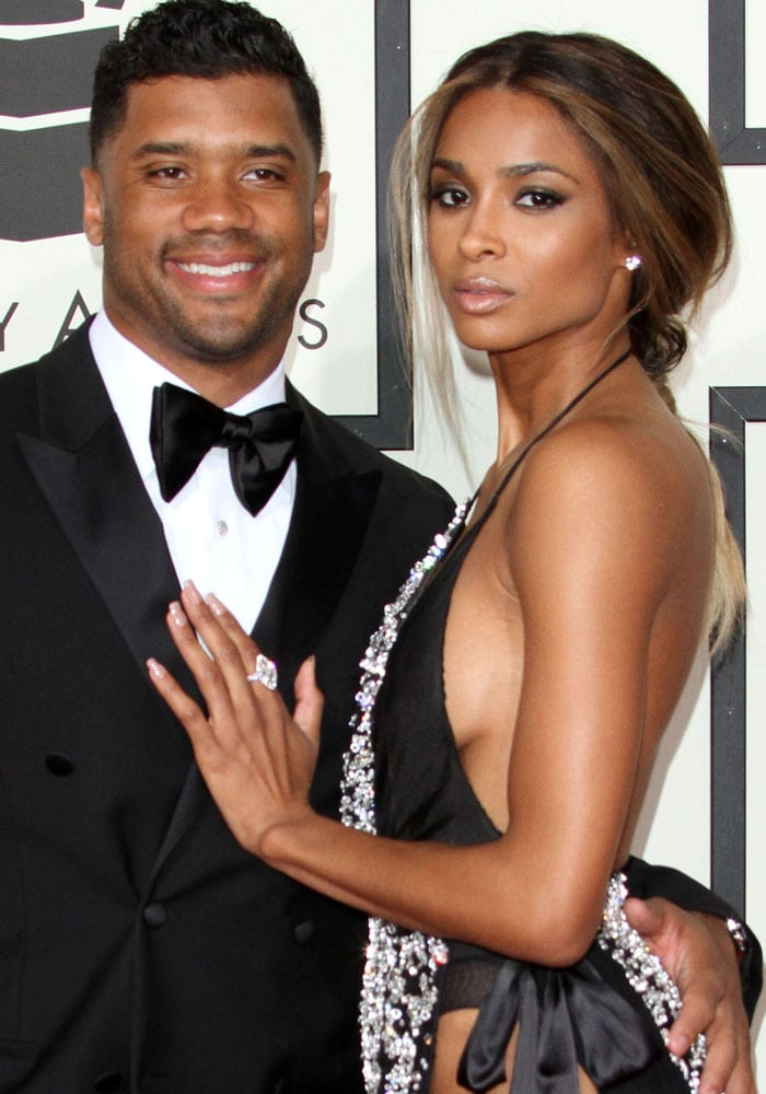 Russell Wilson and Ciara pose for photos at the 2016 Grammys