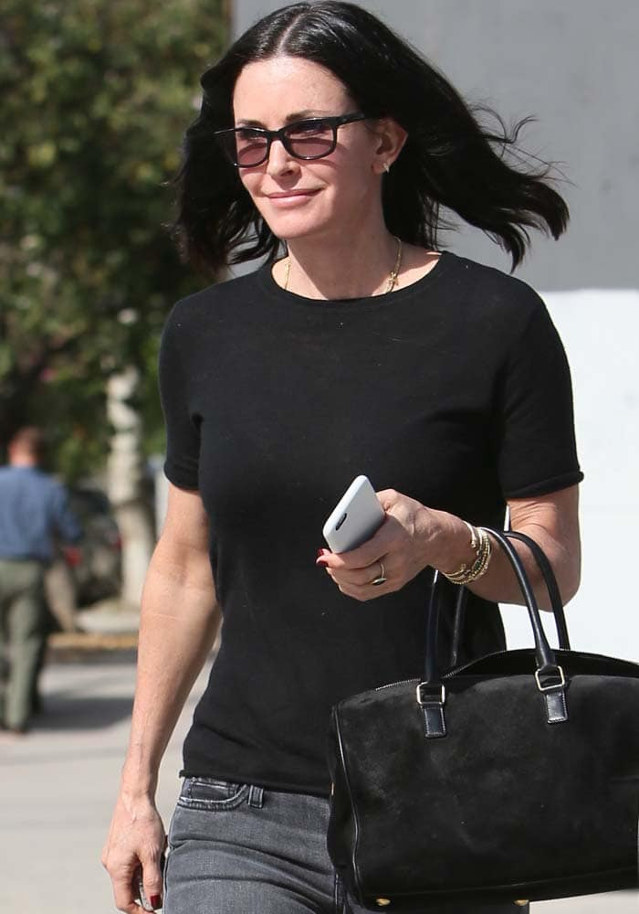 Courteney Cox wears her hair down as she leaves Le Pain Quotidien with a friend
