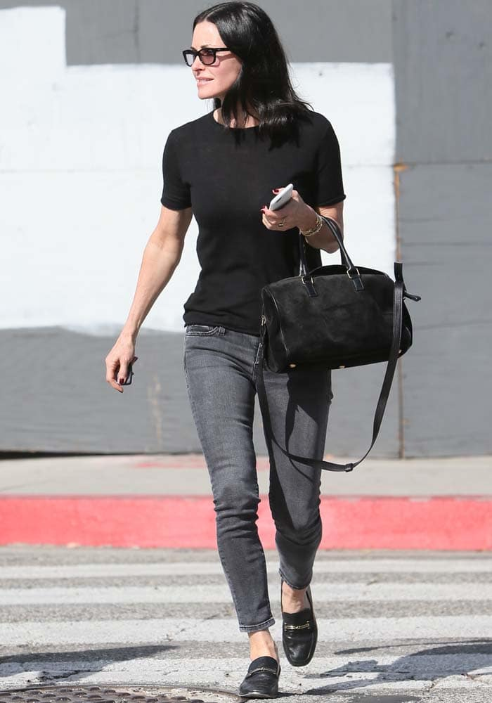 Courteney Cox goes casual in a black tee and gray jeans
