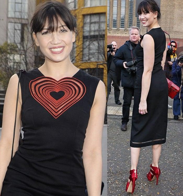 Daisy Lowe flaunts her legs in a form-fitting black dress