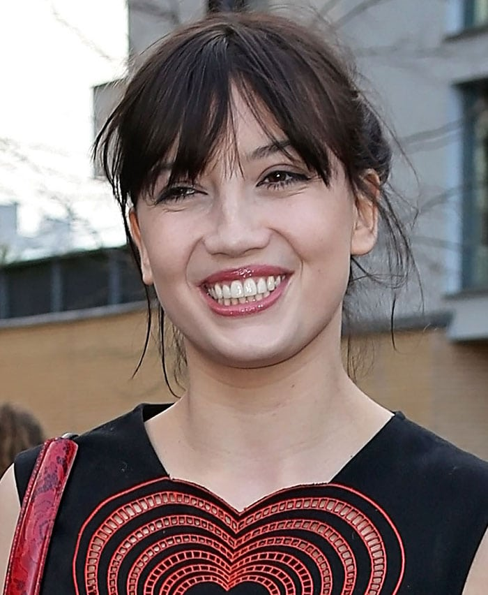 Daisy Lowe's dark tresses were pulled up into a messy but chic updo