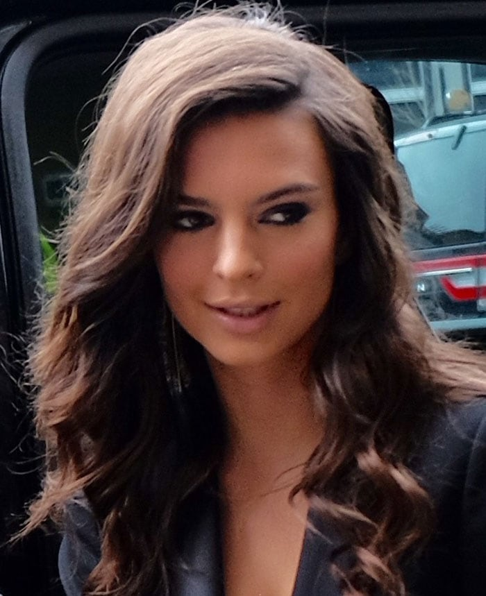 Emily Ratajkowski wears her hair down and curled at the Hugo Boss fashion show