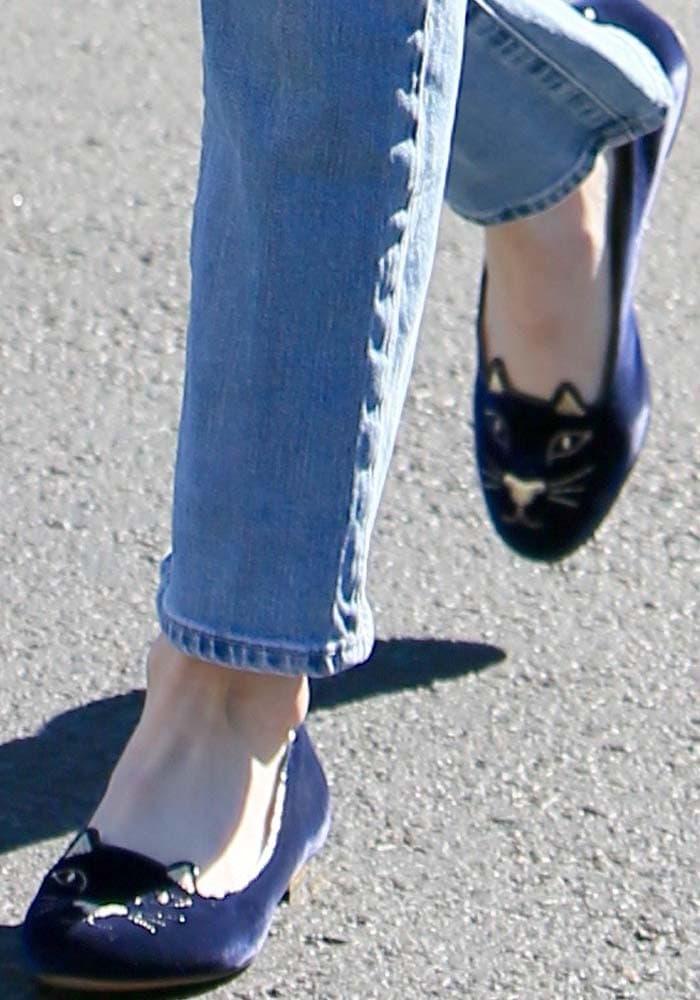 "Emma Roberts wears blue velvet Charlotte Olympia ""Kitty"" flats"