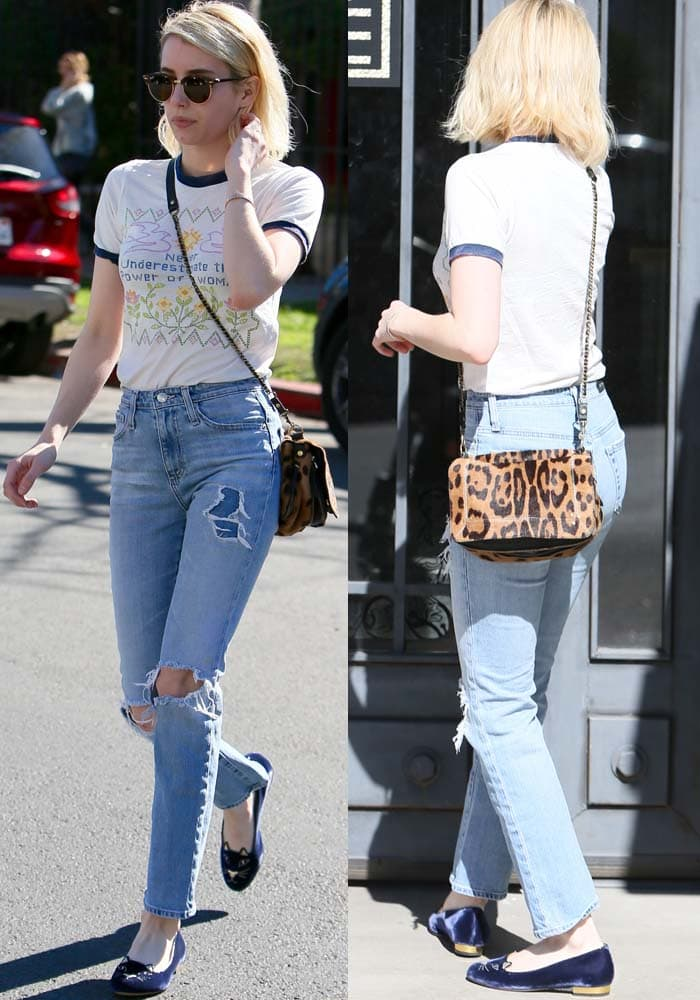 Emma Roberts wore high-waisted straight leg jeans with a leopard print satchel