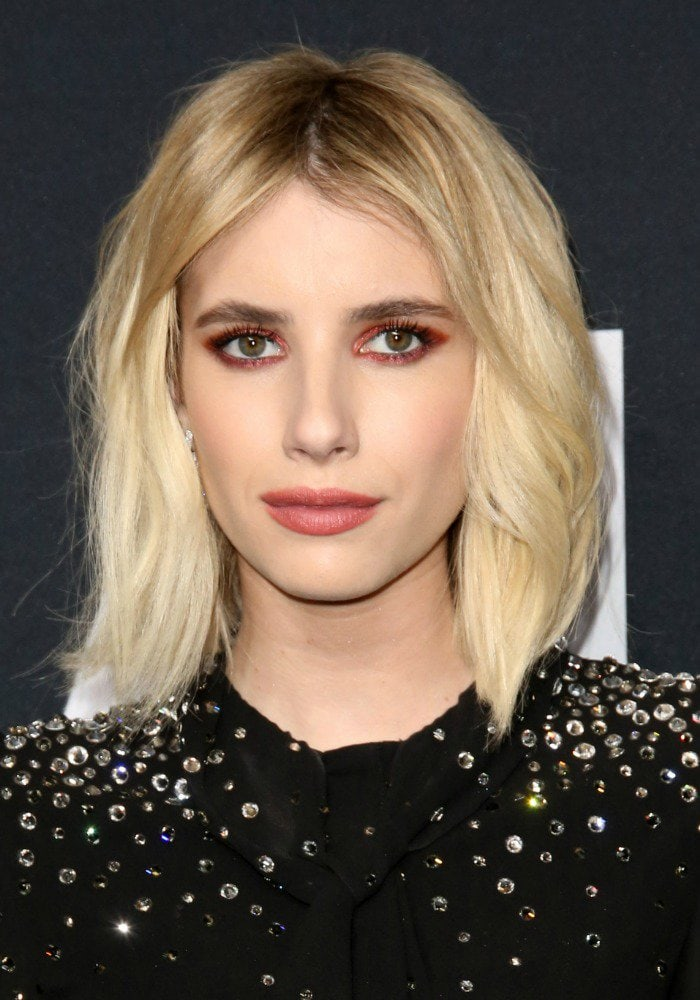Emma Roberts shows off her new short blonde hair at the Saint Laurent fashion show