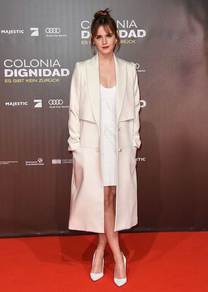 Emma Watson wears a cream-colored Behno coat on the red carpet