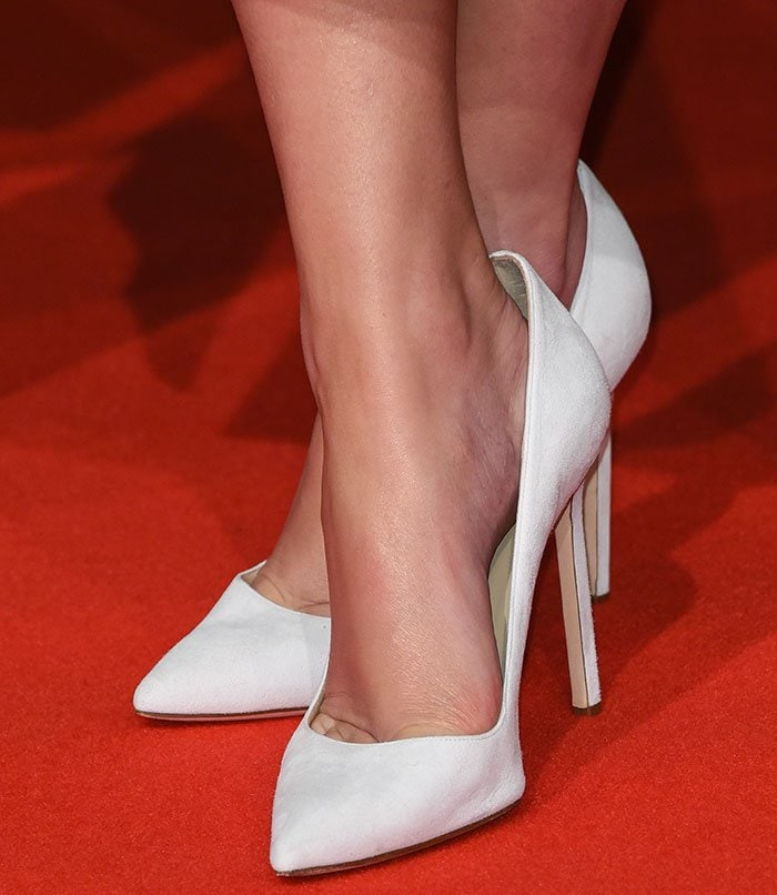 Emma Watson's feet in white Manolo Blahnik pumps