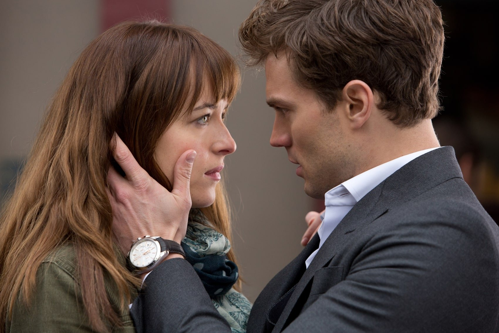 "Dakota Johnson as Anastasia ""Ana"" Steele and Jamie Dornan as Christian Grey in the 2015 American erotic romantic drama film Fifty Shades of Grey"