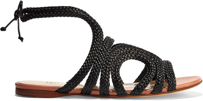 This braided flat sandal is set on a comfortably cushioned footbed and a pretty antique-rose sole