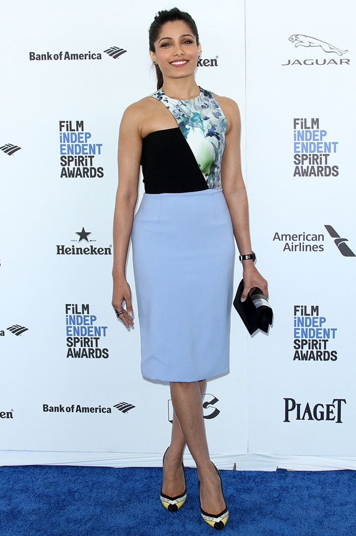 Freida Pinto wears her hair back at the 31st Film Independent Spirit Awards