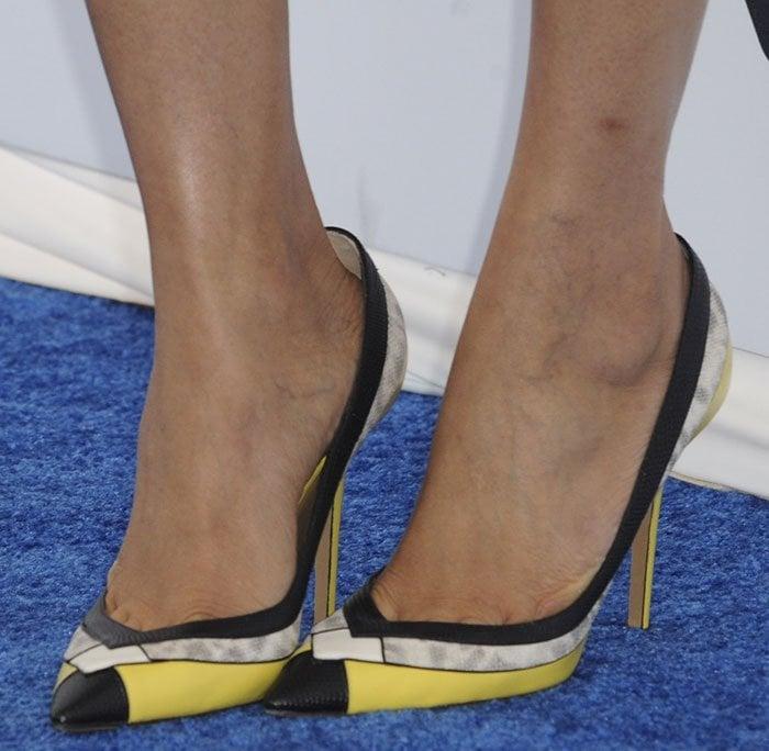 Freida Pinto's feet in yellow-and-black Salvatore Ferragamo pumps