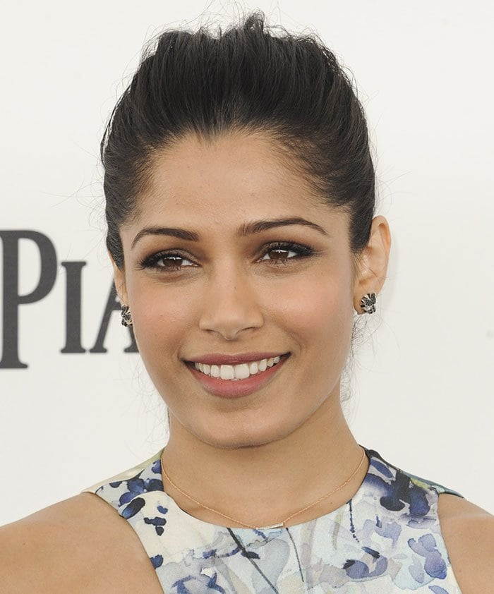 Freida Pinto highlights her bone structure with a chic ponytail