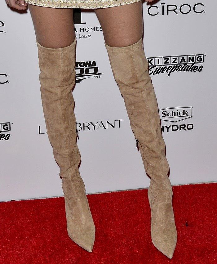 Gigi Hadid wears a pair of suede Le Silla thigh-high boots