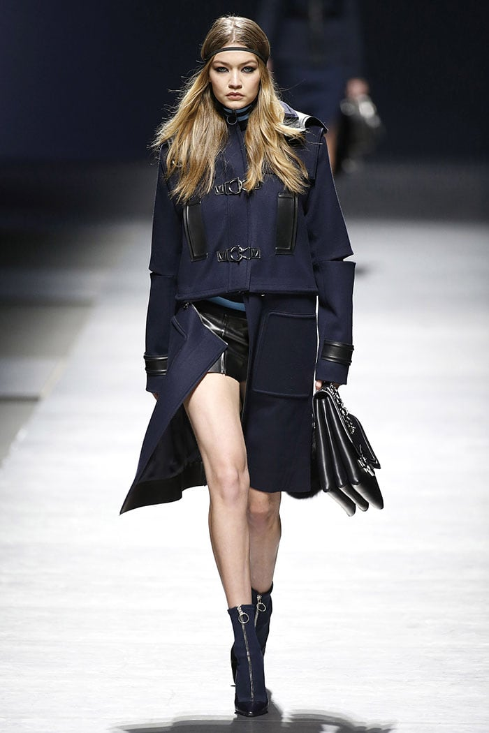 Gigi Hadid modelling the scuba pumps-boots on the Versace fall 2016 fashion show runway.
