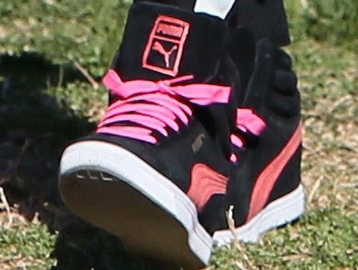Gwen Stefani's feet in pink Puma wedge sneakers