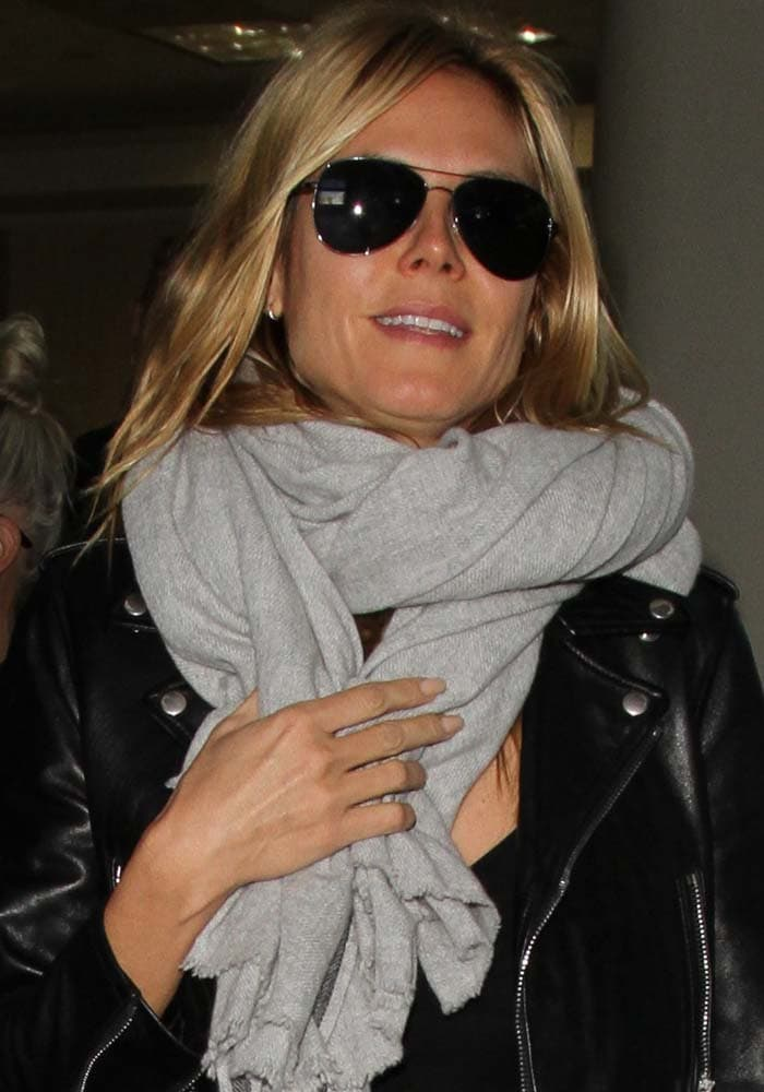 Heidi Klum wears her hair down as she arrives at Los Angeles International Airport