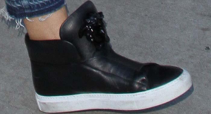 Heidi Klum rocks black Versace Medusa sneakers