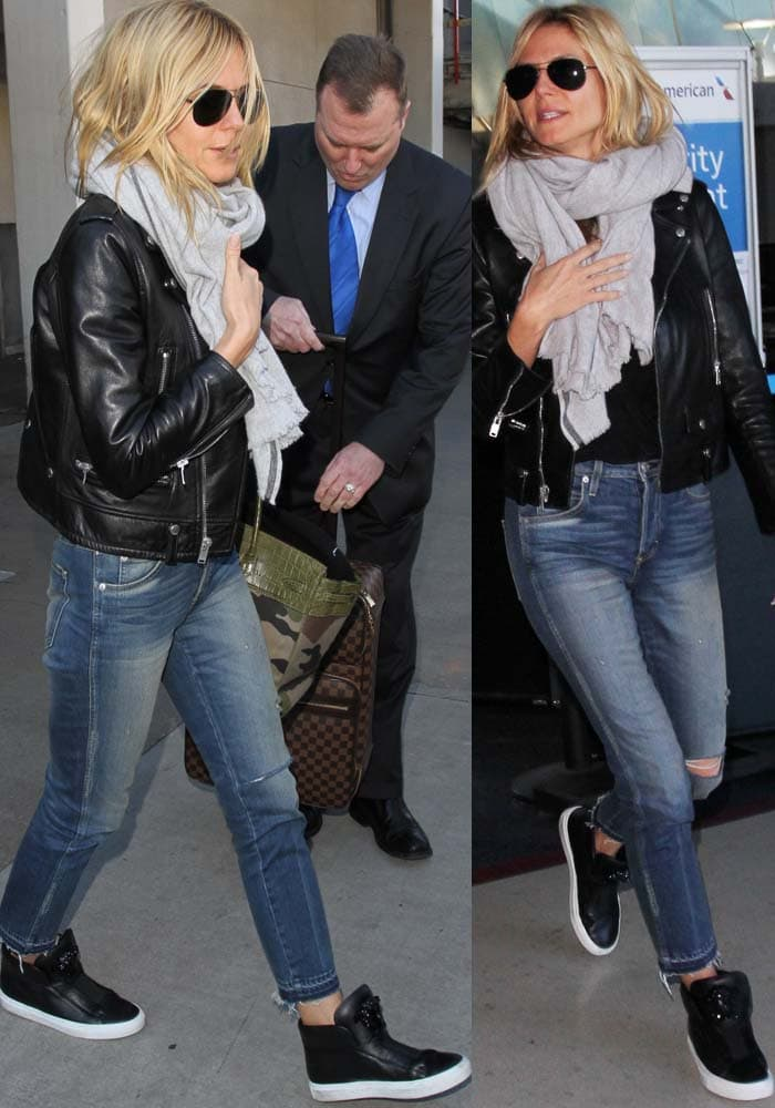 Heidi Klum arrives at LAX in a black-and-denim ensemble topped with a Saint Laurent leather jacket