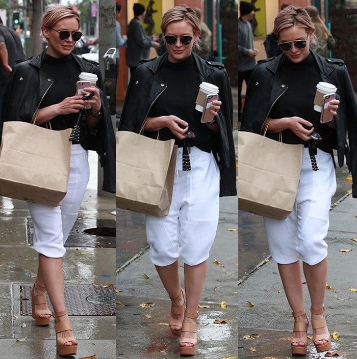 Hilary-Duff-black-leather-jacket-top-white-jogger-shorts