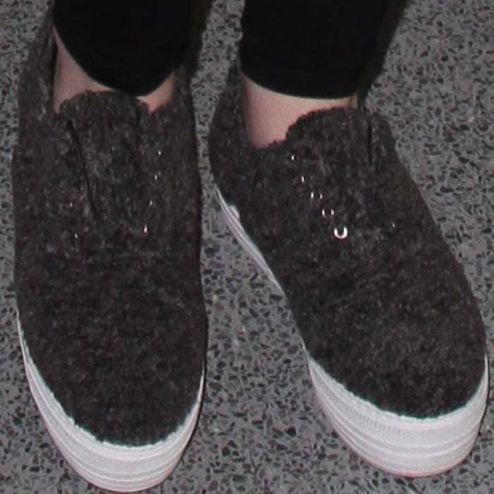 Iggy Azalea's feet in shearling Joshua Sanders sneakers