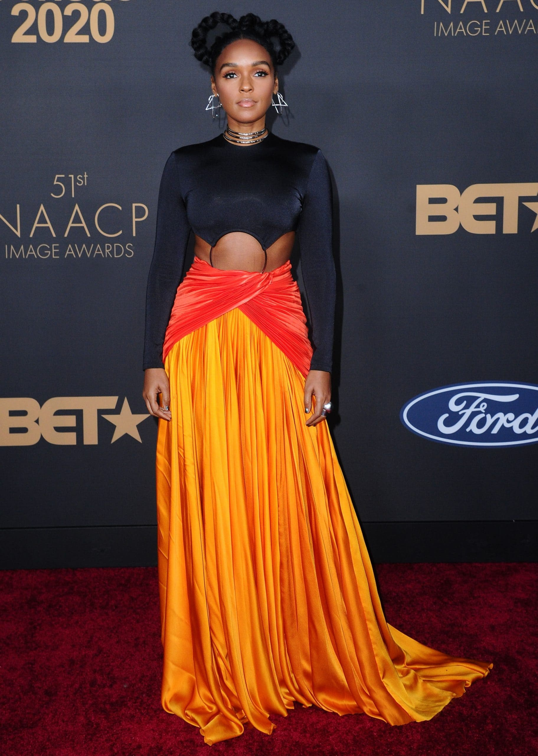 Janelle Monae wore two Balmain pieces with Alexis Bittar rhodium necklaces and a hairpiece at the 2020 NAACP Image Awards
