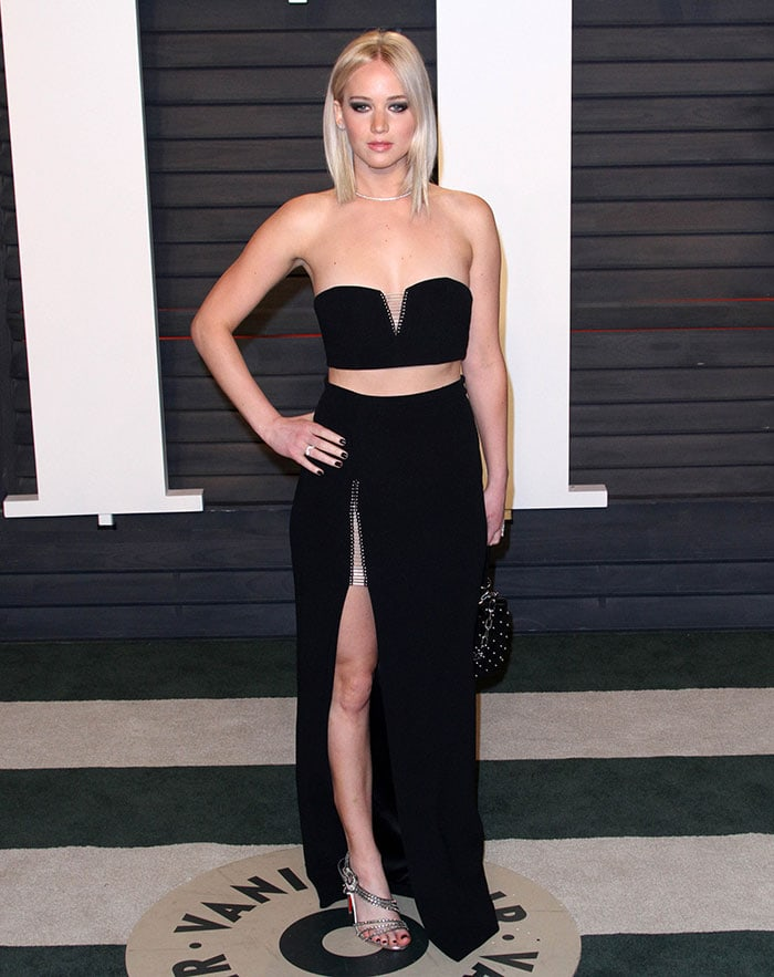 Jennifer Lawrence showed off her abs and legs by slipping her slender figure into a black two-piece ensemble