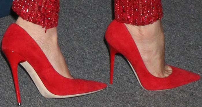 Jennifer Lopez slips into the classic Jimmy Choo 'Abel' Pumps in red suede