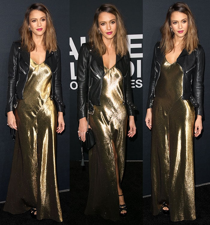 Jessica Alba wears a Saint Laurent gold dress and leather jacket