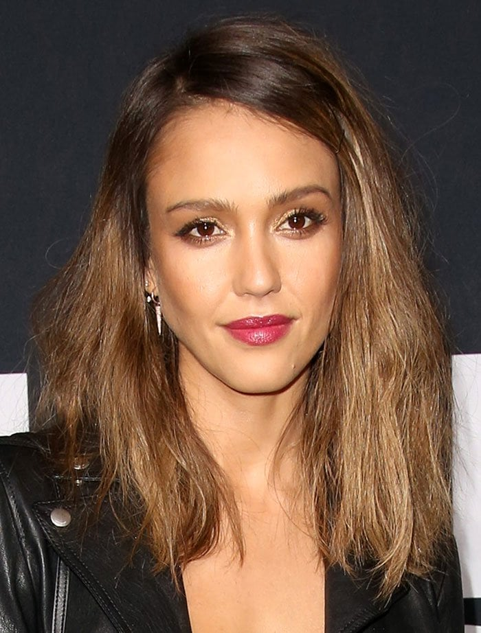 Jessica Alba wears berry-colored lipstick and shimmering eye makeup to the debut of Saint Laurent's latest collection