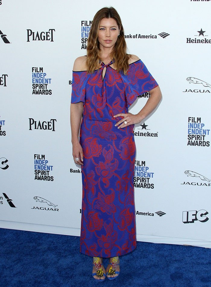 Jessica Biel shows off the pattern on her bright Roland Mouret dress on the blue carpet