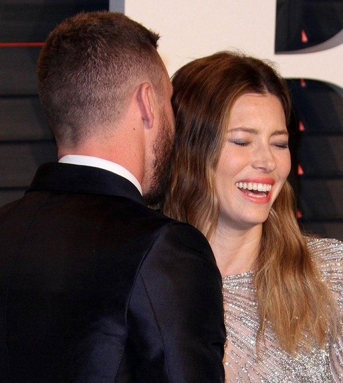 Justin Timberlake kisses Jessica Biel's hair at the 2016 Vanity Fair Oscar Party