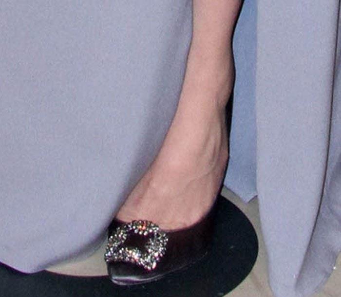 Jessica Biel's feet in embellished Manolo Blahnik pumps