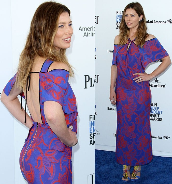 Jessica Biel highlights her ass and shows off the open back of her patterned Roland Mouret dress