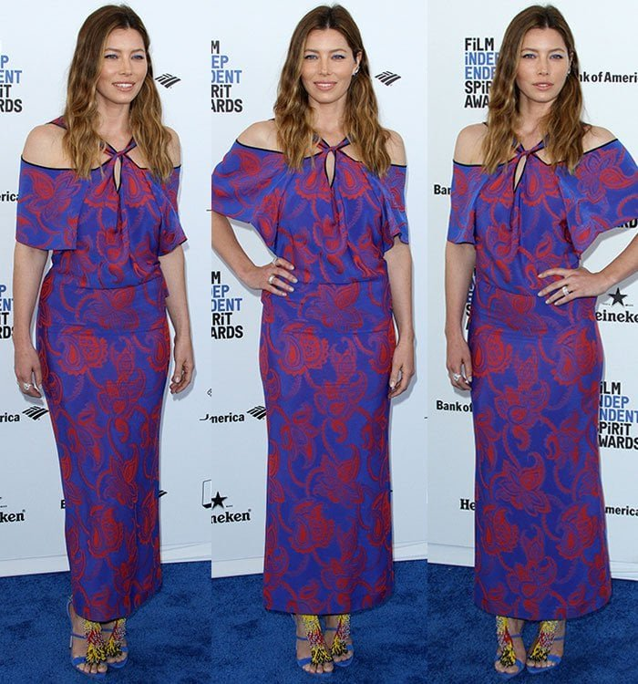 Jessica Biel wears a paisley-printed Roland Mouret dress with yellow-accented sandals