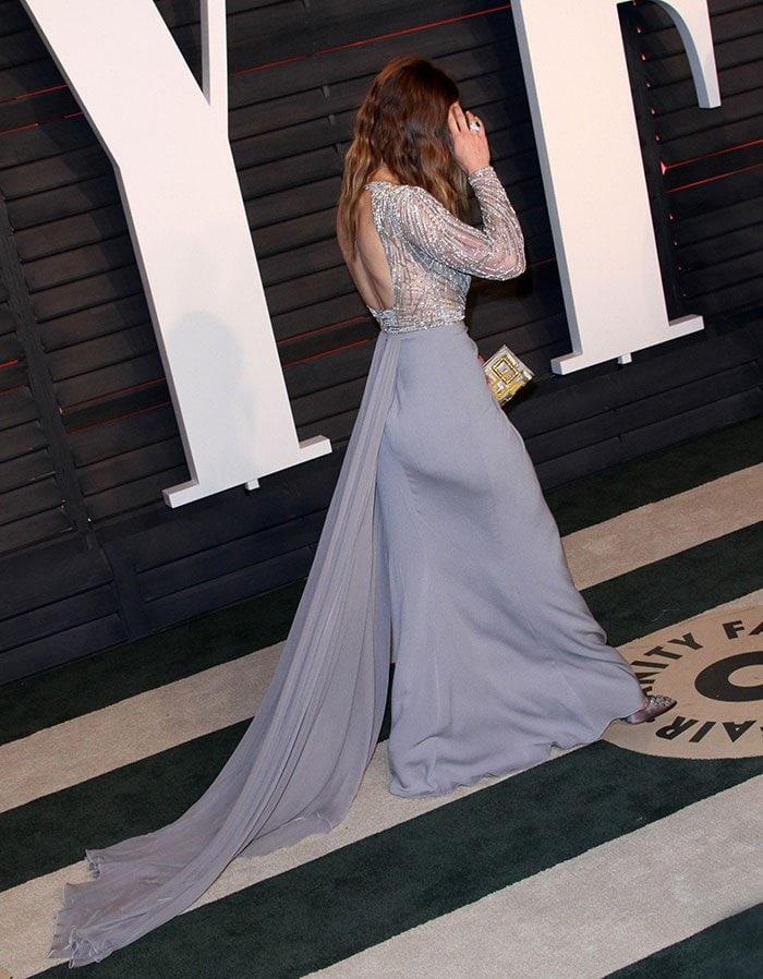 Jessica Biel shows off the long train of her Zuhair Murad dress