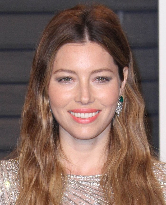 Jessica Biel wears a pair of emerald and diamond earrings and keeps her makeup light