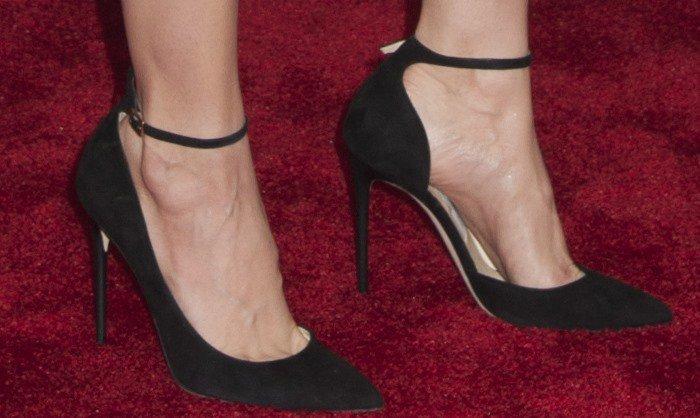 Alison Brie's feet in black Jimmy Choo pumps