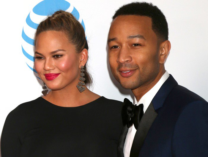 Chrissy Teigen and John Legend pose for photos on the red carpet of the NAACP Image Awards