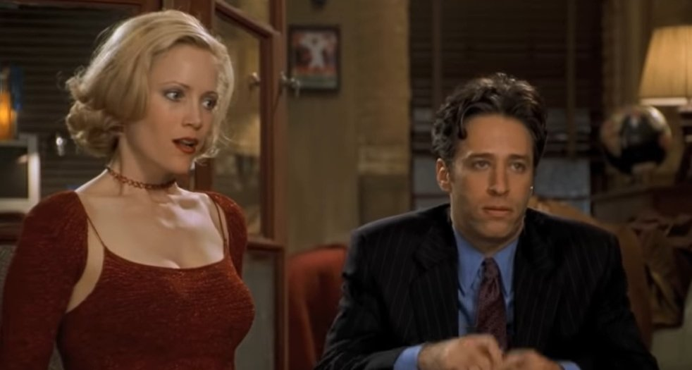 Leslie Mann with fake boobs as Corinne Maloney and Jon Stewart as Kevin Gerrity in Big Daddy
