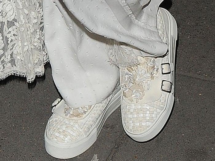 Karlie Kloss wears buckled white woven Alexander McQueen sneakers