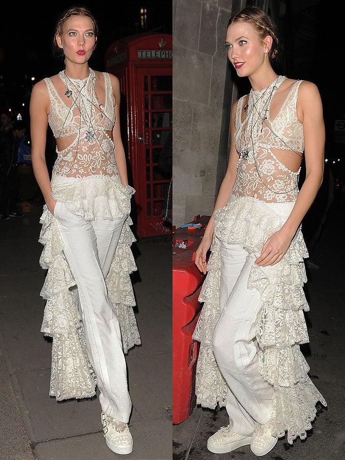 Karlie Kloss wears a ruffled lace Alexander McQueen ensemble out in London