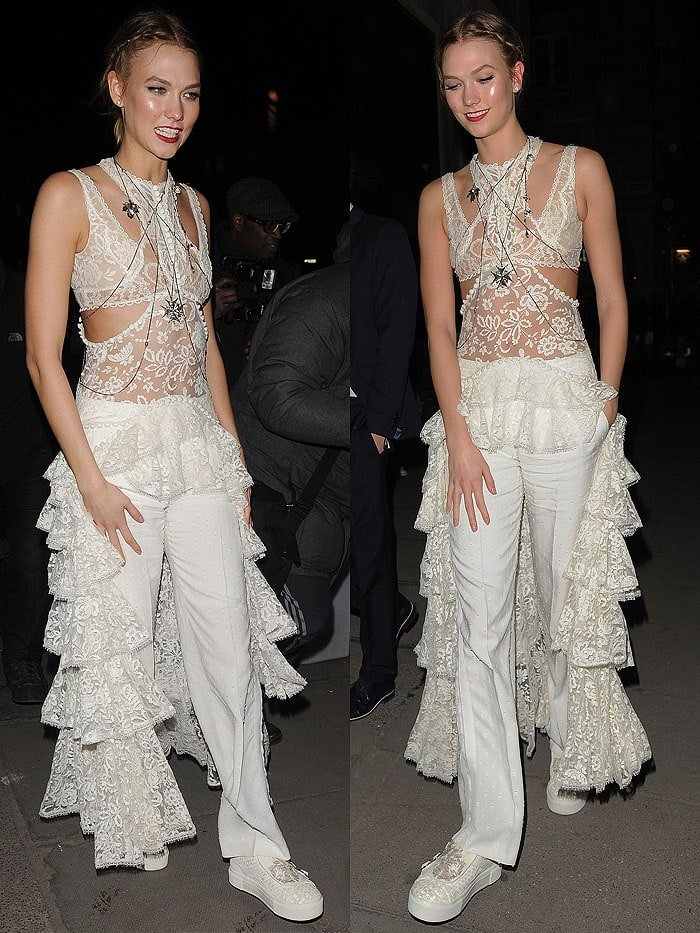 Karlie Kloss accessorizes her all-white look with a jeweled body harness