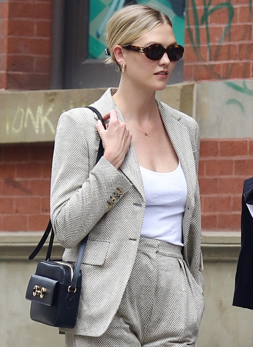 Karlie Kloss styled her Max Mara suit with a bag from Gucci's vintage-inspired '1955' collection