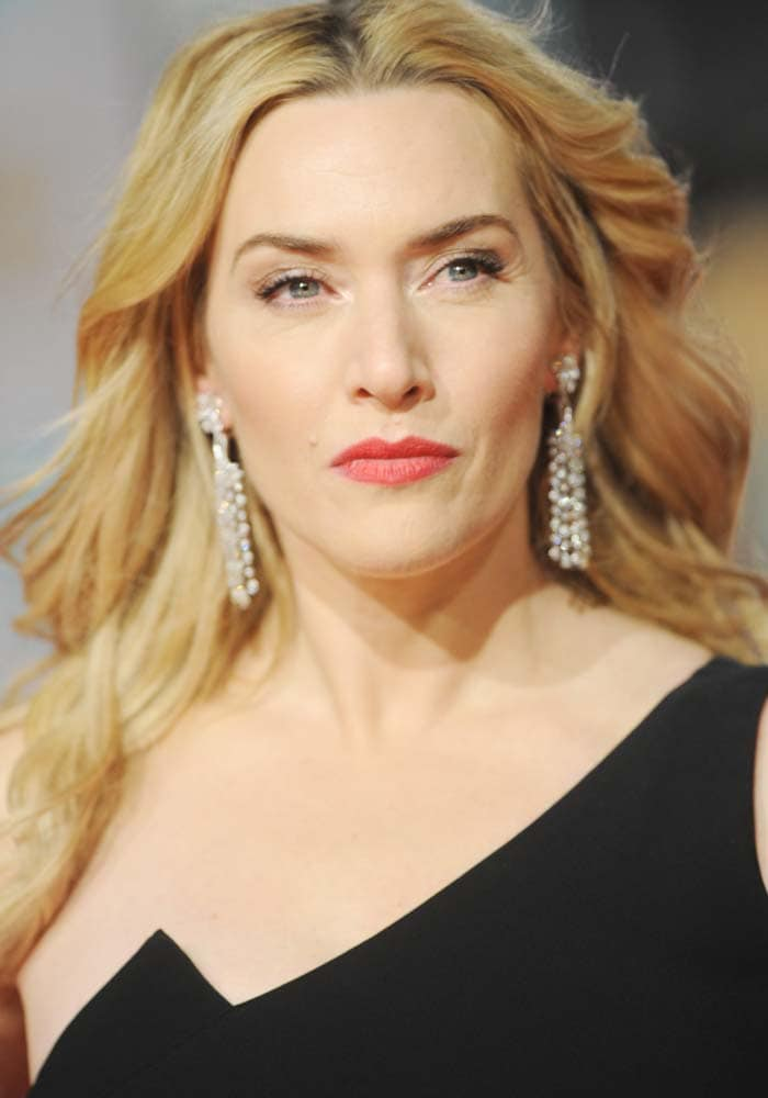 Kate Winslet wears her blonde hair in curls at the British Academy Film Awards